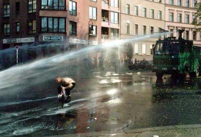 Water cannon during a German demonstration, 2001. Image Wikipedia